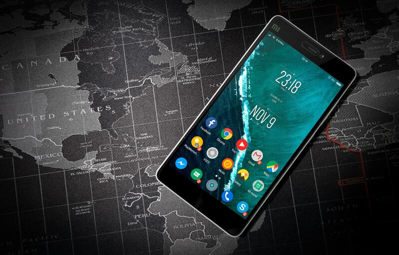 An Android phone on a map of the world.